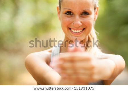Photo of gorgeous blond woman doing stretching exercises - stock photo
