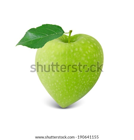 Photo of green apple with leaf in a heart shape