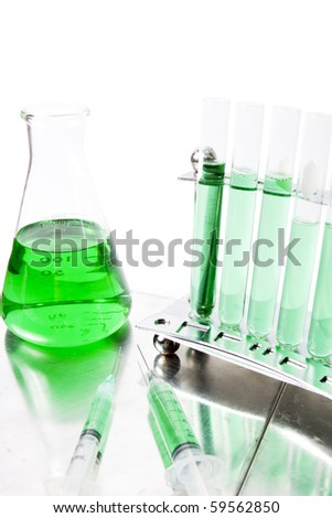 photo of green laboratory equipment to represent environmental responsability - stock photo