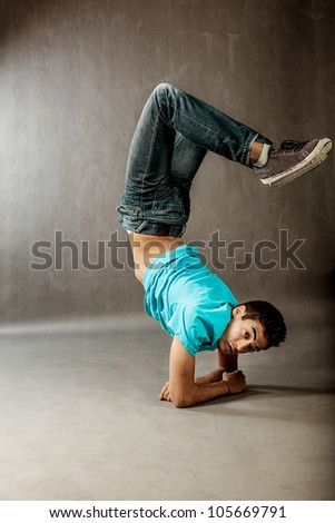 photo of guy performing acrobatical dance movements
