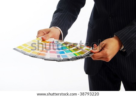 Photo of hands holding a color guide - stock photo