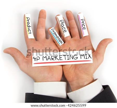 Photo of hands holding paper cards with 4P MARKETING MIX concept words - stock photo