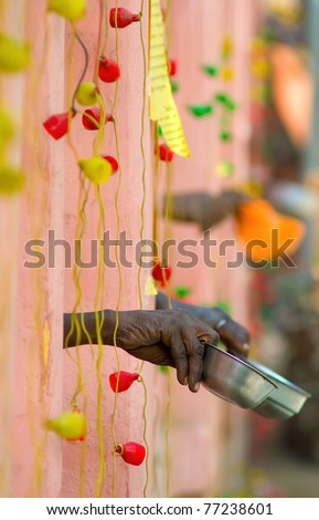 photo of hands of beggars who ask for money near Mahabodha in Bodh Gaya, Bihar, India - stock photo