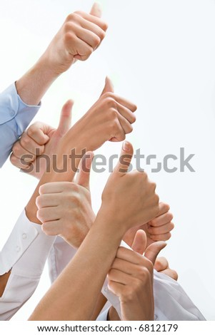 Photo of hands showing sign of okay placed one above the other - stock photo