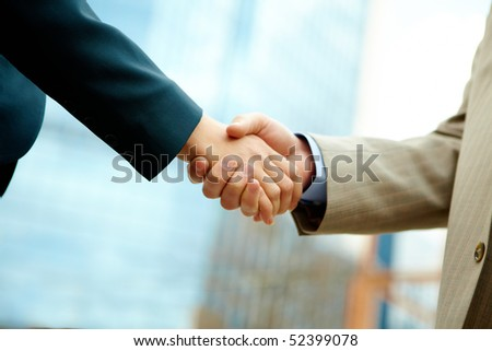Photo of handshake of business partners after striking deal