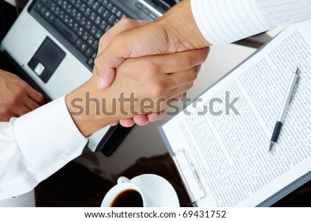 Photo of handshake of business partners after striking deal - stock photo