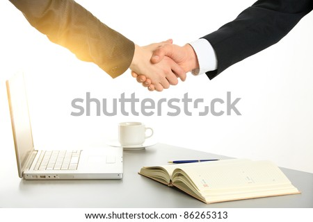 Photo of handshake of business partners after striking deal. Closeup. - stock photo