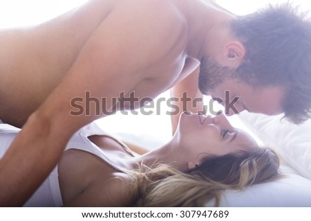 Photo of handsome male and his beautiful female lover - stock photo