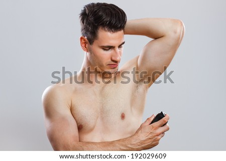 Photo of handsome man shaving chest,Man shaving his chest - stock photo