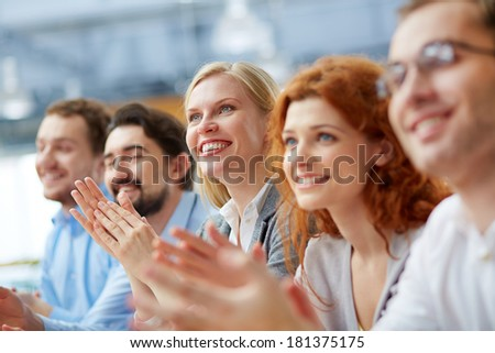 Photo of happy business partners applauding at conference - stock photo