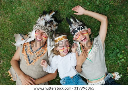photo of happy children with native american costumes - stock photo