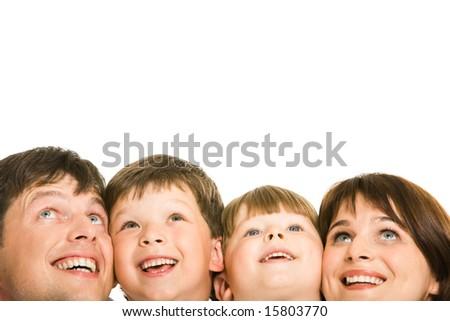 Photo of happy family looking upwards on white background - stock photo