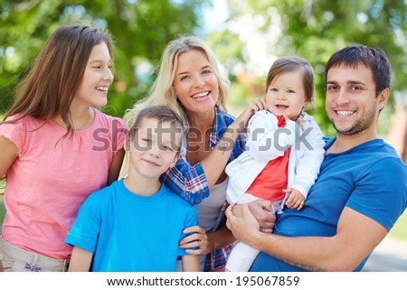 Photo of happy family spending leisure outdoors - stock photo