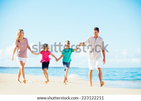 Photo of Happy Family Walking Down the Beach. Summer Lifestyle. - stock photo
