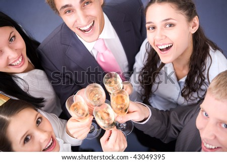 Photo of happy friends cheering up during corporate party - stock photo
