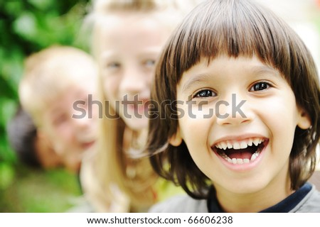 Photo of happy girls with handsome lads in front smiling at camera - stock photo