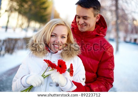Photo of happy man and woman outdoor in winter
