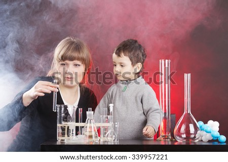 photo of happy mother with son studying chemistry