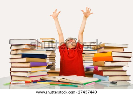 Photo of happy preschooler with his arms raised screaming in excitement - stock photo