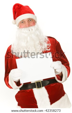 Photo of happy Santa Claus with blank paper looking at camera