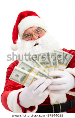 Photo of happy Santa Claus with dollar bills looking at camera - stock photo