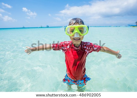 Photo of happy snorkeling boy in yellow mask