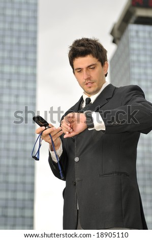 Photo of happy winner businessman  talking on mobile phone - stock photo