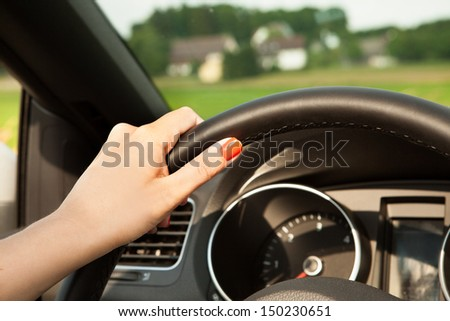 Photo of Happy Young Woman Driving The Car - stock photo