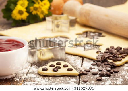Photo of home made biscuits over wooden table - stock photo