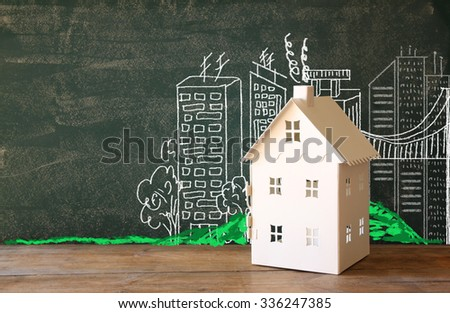 photo of house and background of blackboard and city drawings. real estate and family house concept  - stock photo