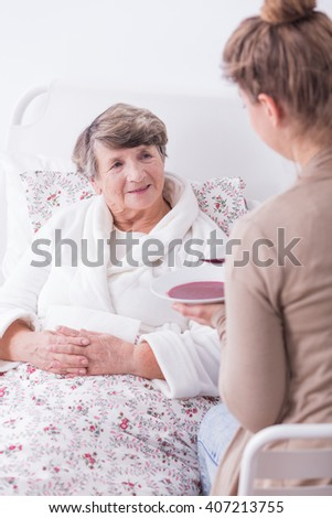 Photo of ill lady having support and care of family