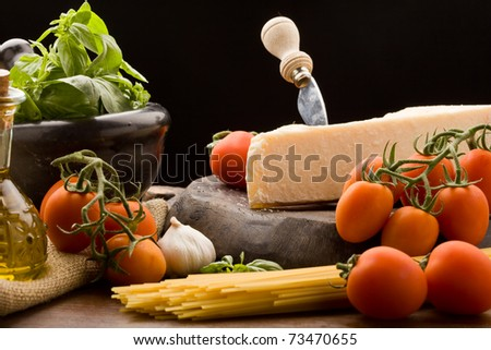 photo of ingredients for cooking spaghetti with tomato sauce - stock photo