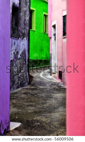 Photo of italian street with multi colored houses on it