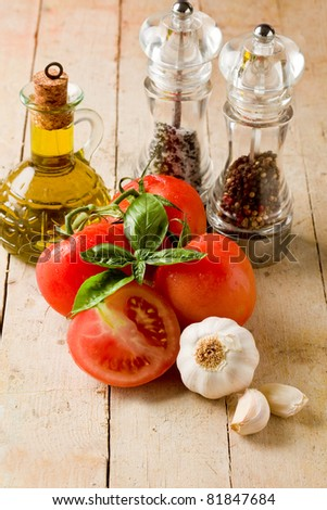 photo of italians most used ingredients for preparing food on wooden table