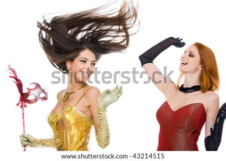 Photo of joyful actresses in fashionable dresses laughing over white background - stock photo