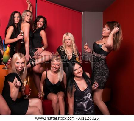 Photo of joyful beautiful friends on the party  - stock photo