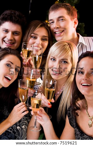 Photo of joyful friends relaxing together at a evening-party - stock photo