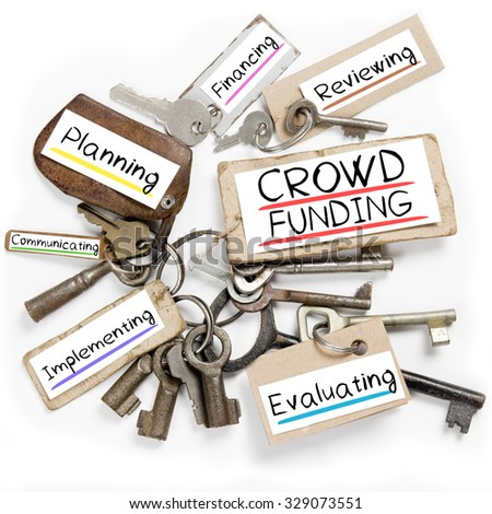 Photo of key bunch and paper tags with CROWD FUNDING conceptual words - stock photo