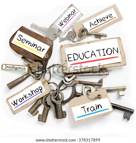 Photo of key bunch and paper tags with EDUCATION conceptual words - stock photo