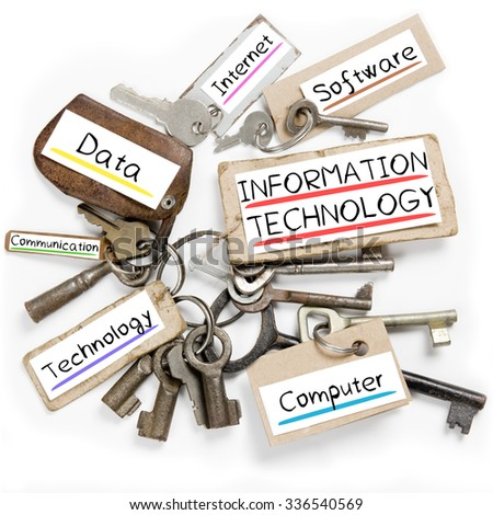 Photo of key bunch and paper tags with INFORMATION TECHNOLOGY conceptual words - stock photo