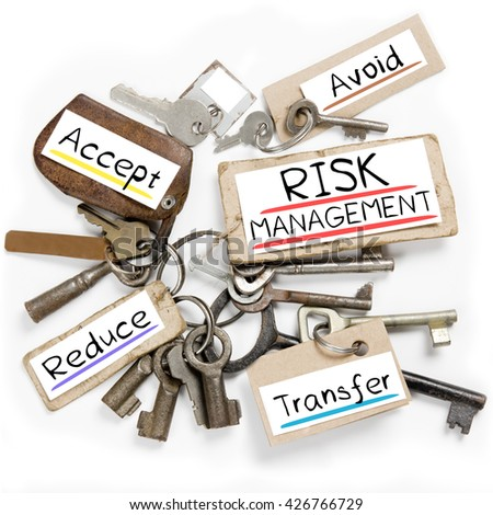 Photo of key bunch and paper tags with RISK MANAGEMENT conceptual words - stock photo
