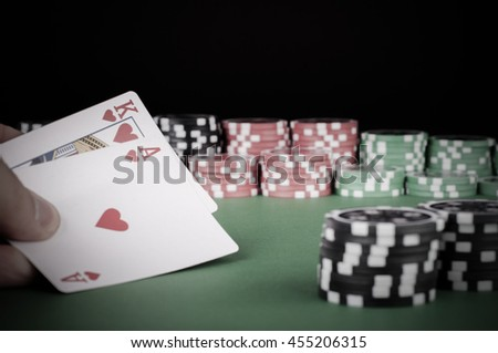 photo of king, ace, black, red and green casino chips on table - vintage