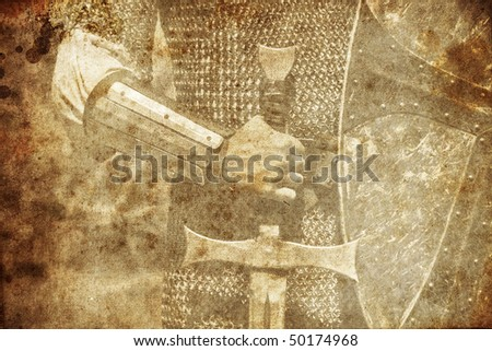 Photo of Knight and sword. Photo in old image style. - stock photo