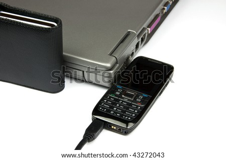 photo of laptop with external hard drive and phone - stock photo