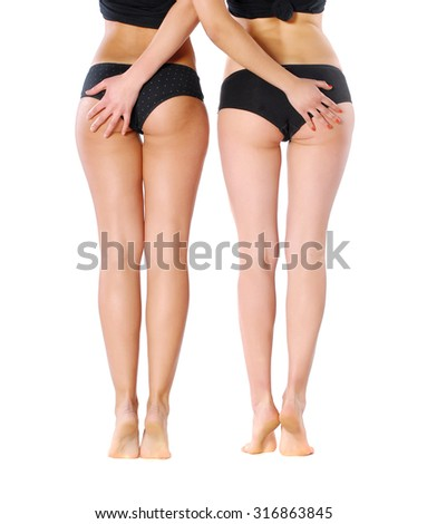 Photo of legs ot two girls. Isolated on white background - stock photo