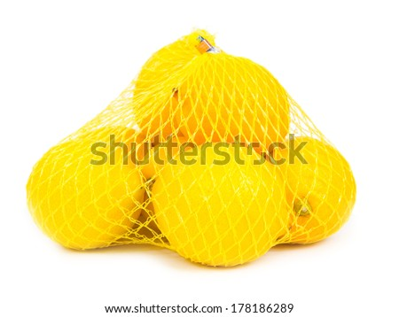 Photo of lemons in a yellow bag isolated on white - stock photo
