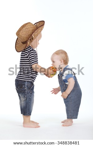 photo of little boy treated friend apple