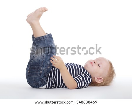 photo of little funny boy on the floor