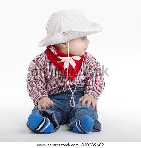 photo of little funny cowboy on white background - stock photo