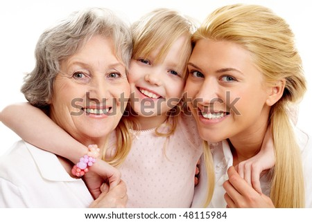 Photo of little girl clutching her grandmother and mother - stock photo